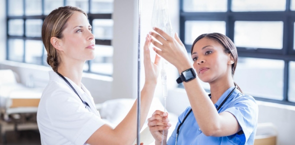 How will a nurse deal with a client with toxoplasmosis and cytomegalovirus who is confused and is dislodging his I.V. access device; he is also supposed to receive amphotericin B (Amphotec) I.V?