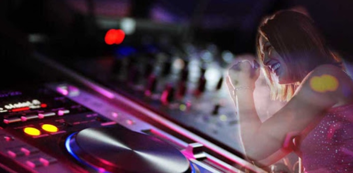 DJ is the acronym for disc jockey. A disc jockey primarily prepares or mixes recorded music by