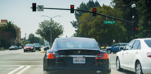 What should I do if I accidentally run a red light?