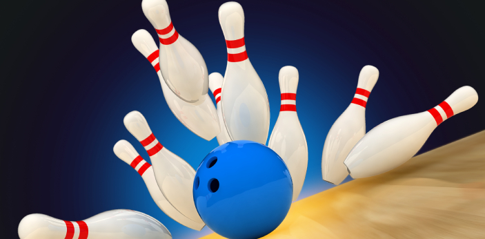 Bowling is a type of game in which a heavy ball is rolled down a long, narrow lane toward a group