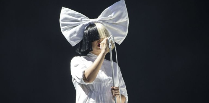 There could be several reasons why Sia does not show her face. She may not show it because she is