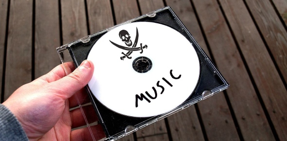 How do people who download pirated music and movies justify their actions?