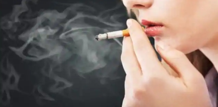 Passive smoking means the involuntary process of inhaling smoke from any tobacco products like