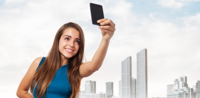 Selfie is a type of photograph you take by yourself, especially the one you take manually by using