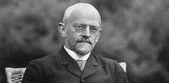 David Hilbert published a book in 1899 about geometry. It is called The Foundations of Geometry.