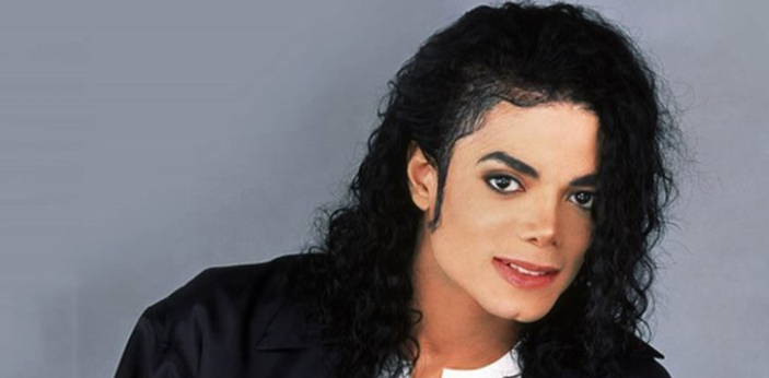 Michael first started wearing gloves to hide his skin condition. The glove was white with glitter