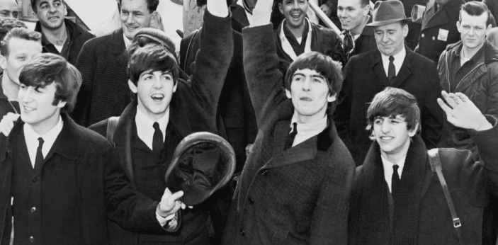 In 1963, The Beatle's enormous popularity first emerged as Beatlemania, foremost music band