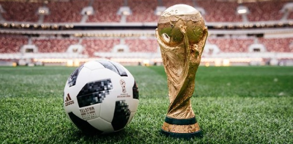 Who designs and makes footballs for the world cups?