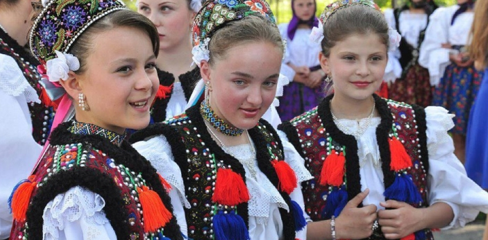 Romanians are an ethnic group who inherently live within the borders of Romania, while Gypsies