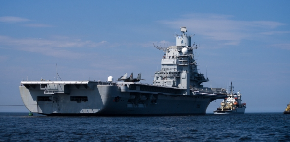 What's the standard procedure for the movement of a US Aircraft carrier (Formation and security measures)?