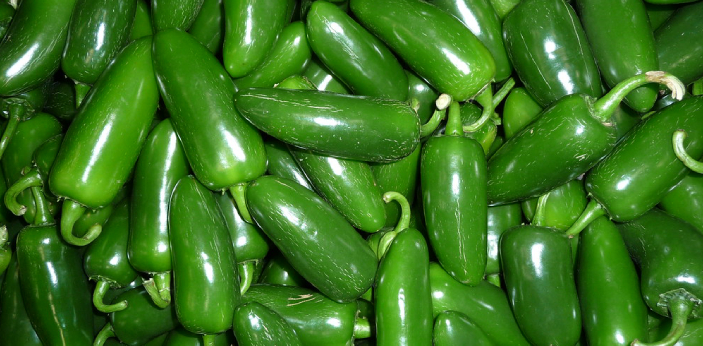 There are two categories of peppers: spicy and sweet. Jalapenos and green chilis are both in spicy