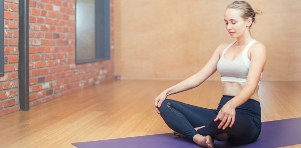 Should I try yoga or Pilates for losing belly fat?