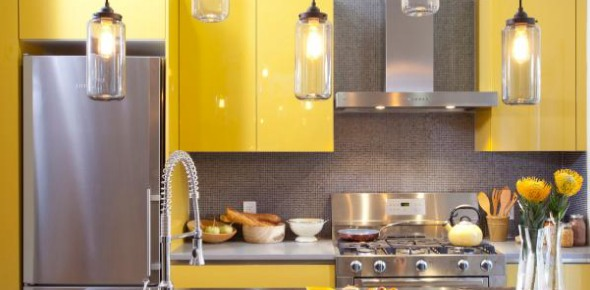 How often should waste be removed from a kitchen area?