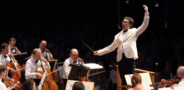 What is the meaning of the word orchestra?