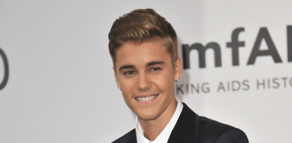 Why doesn't Justin Bieber smile as much as he used to?