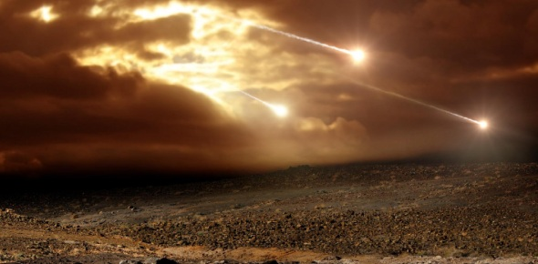 What atmospheric layer protects US by burning up most meteors?