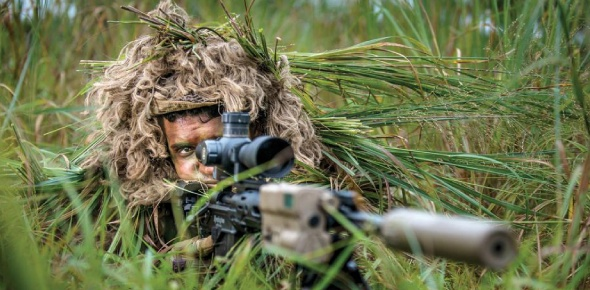 Snipers are taught to camouflage themselves in an environment. They have certain equipment that can