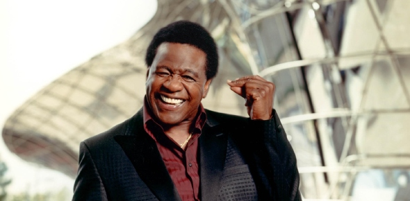 Al Green is alive, and he is best known for recording a series of soul hit singles in the early